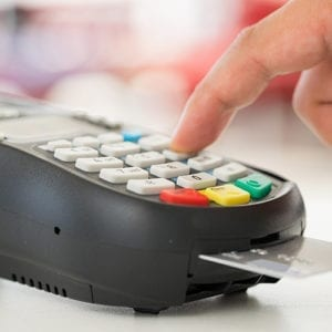 Chip credit card reader being used