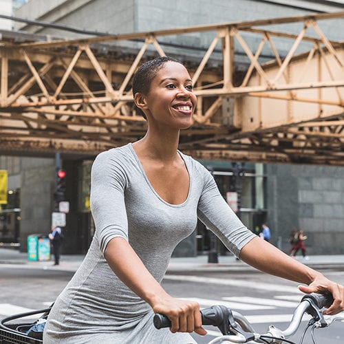 Woman on bike in downtown Chicago